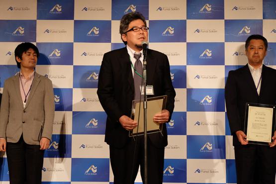 受賞スピーチをする新家SSIラボ代表取締役